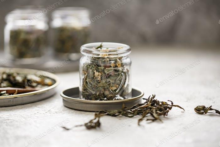 Various herbal tea in small glass