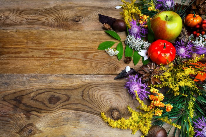 Fall greeting with yellow autumn flowers on wooden table