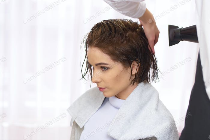 Young woman at the hairdresser