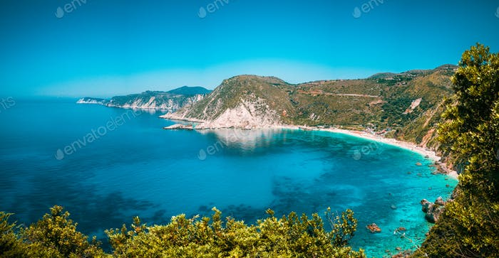 Panorama View to Petani beach with transparent and crystal clear blue mediterranean sea water in
