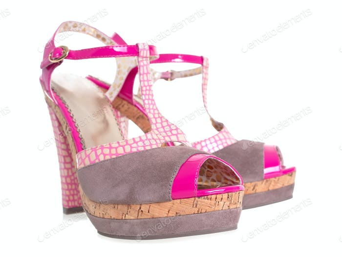 Funny pink high heels shoes 3d effect on white background