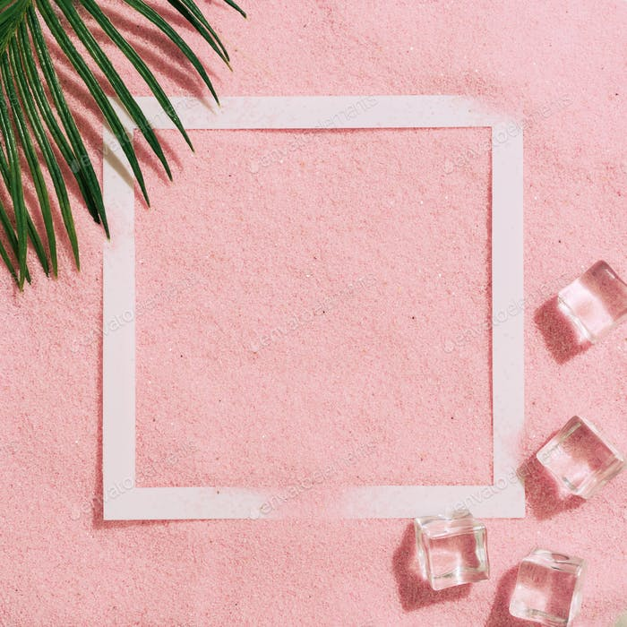 Summer day scene with ice cubes and tropical palm leaf on pink sand pastel color background.
