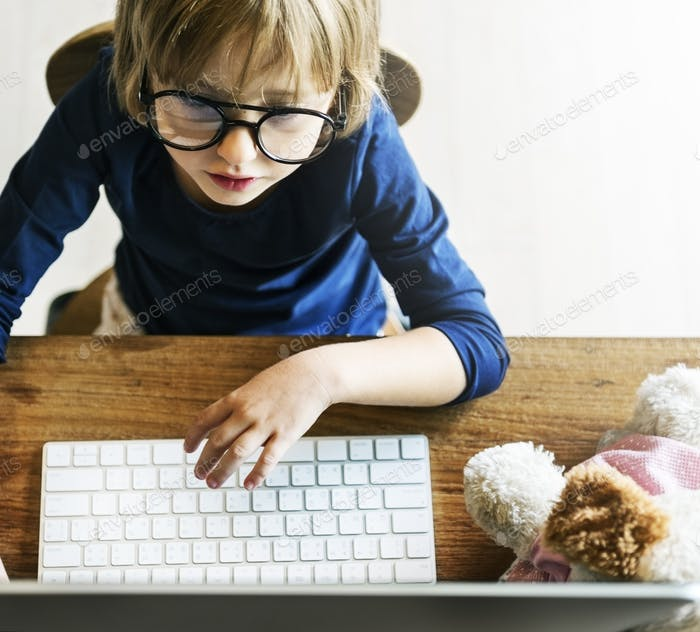 Little Girl Using Computer Concept
