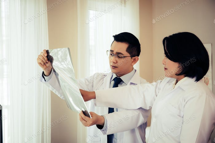 Close up of doctor holding x-ray, x-ray film of patient at hospital.