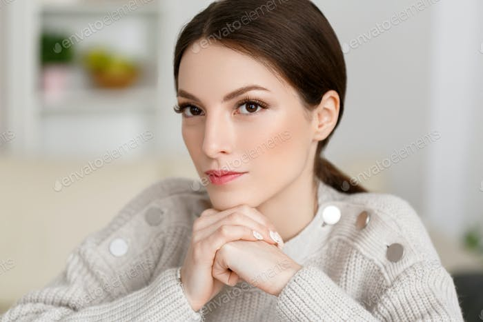 Woman in sweater over white background, beautiful female brunette  hair brunette concept.