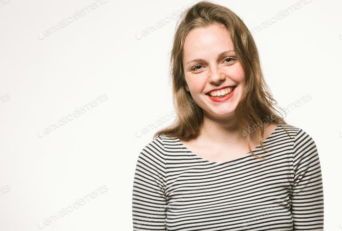 Woman portrait in stripes dress studio on white
