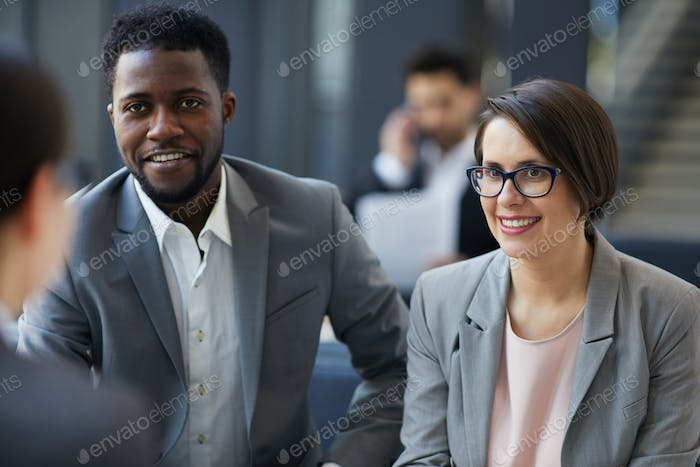 Business people interested in idea of colleague