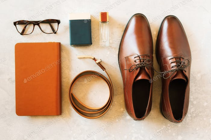 Set of stylish accessories for man on gray background. Flat lay of elegant belt, glasses, parfume