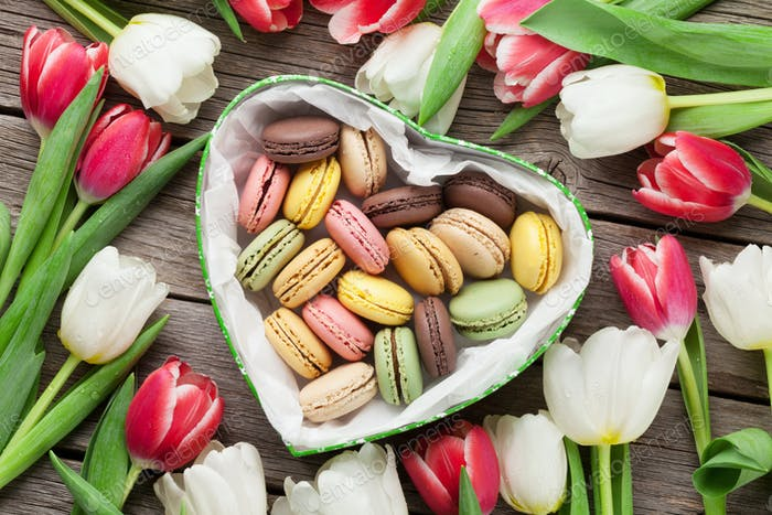 Colorful tulips bouquet and macaroons