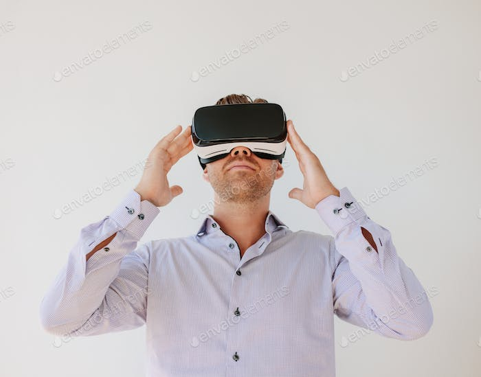Man wearing a pair of VR glasses
