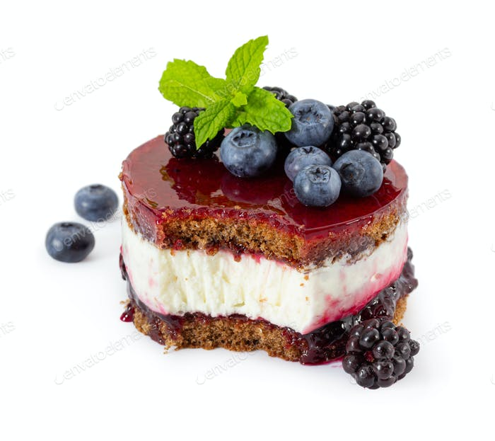 Cheesecake with fresh mint, blueberries and blackberries, blueberry jam and jelly
