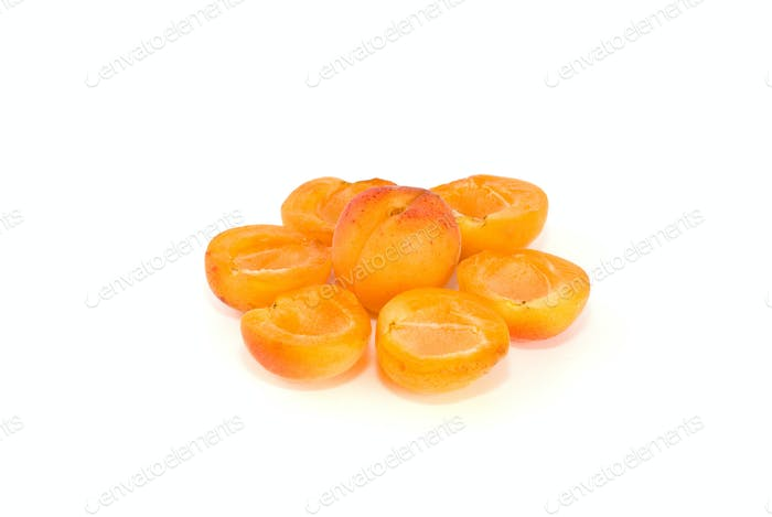 One whole and six apricot halves lying in form of flower