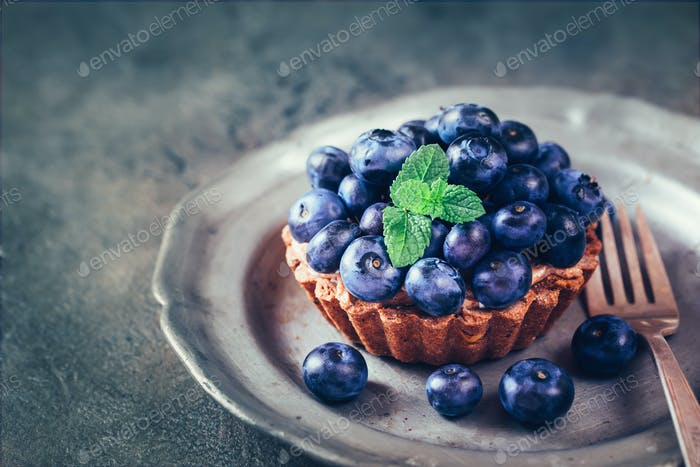 Blueberry mini tarts on plate