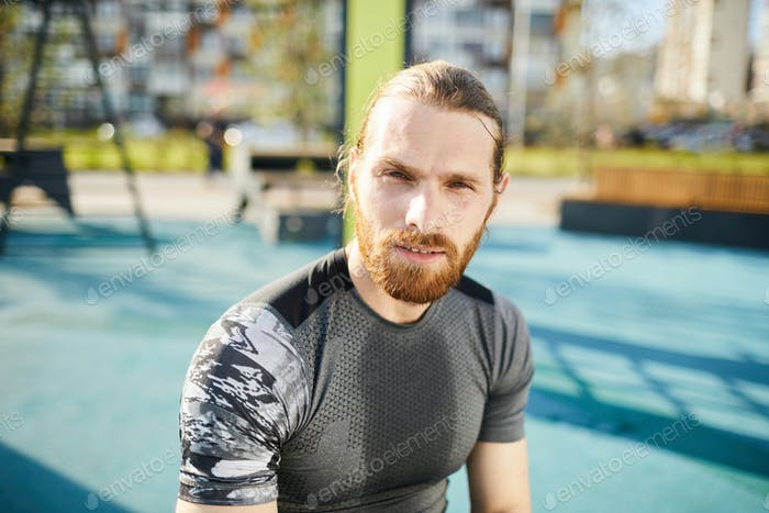 Red-bearded man in sports tshirt