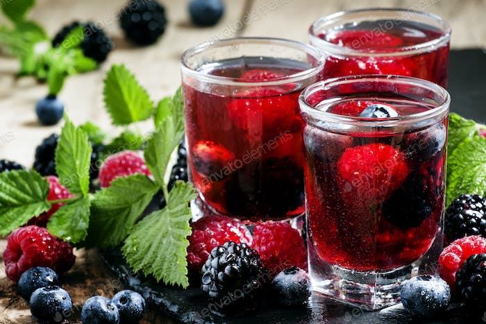 Cold summer berry tea with raspberries, blueberries, blackberries and mint