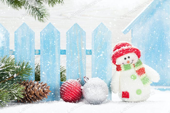 Christmas snowman and bauble toys and fir tree