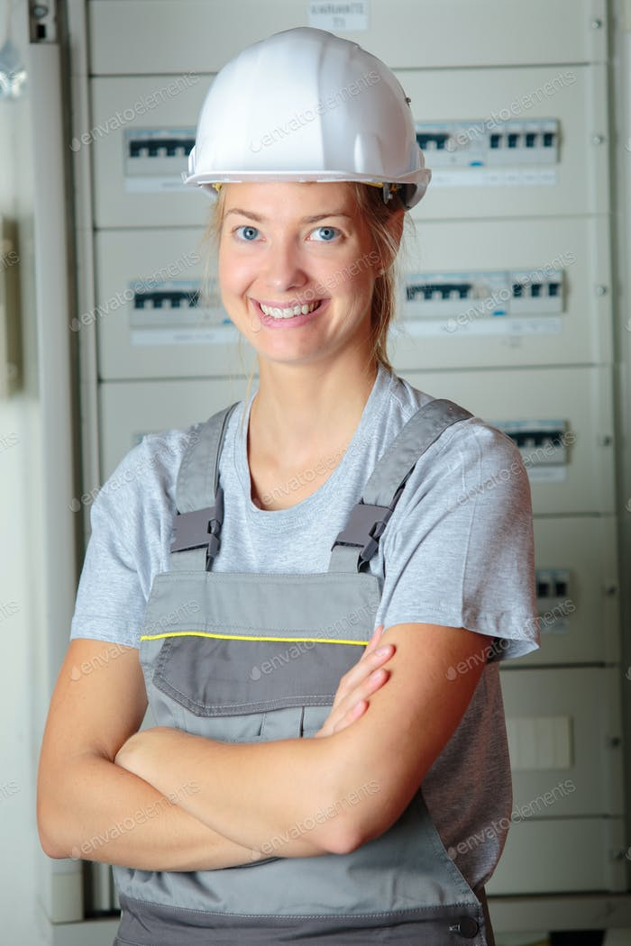Portrait of woman wearing safety helmet