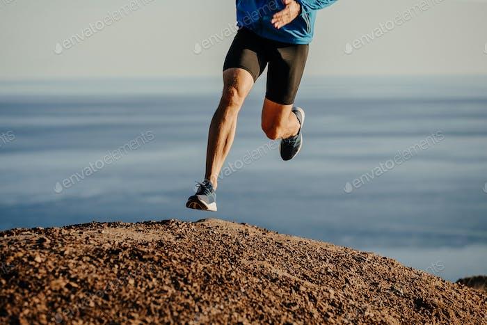 athlete runner running uphill mountain