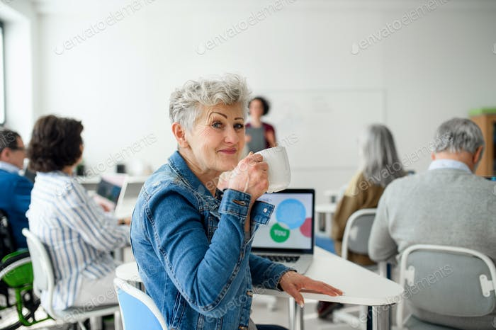 Portrait of senior attending computer and technology education class
