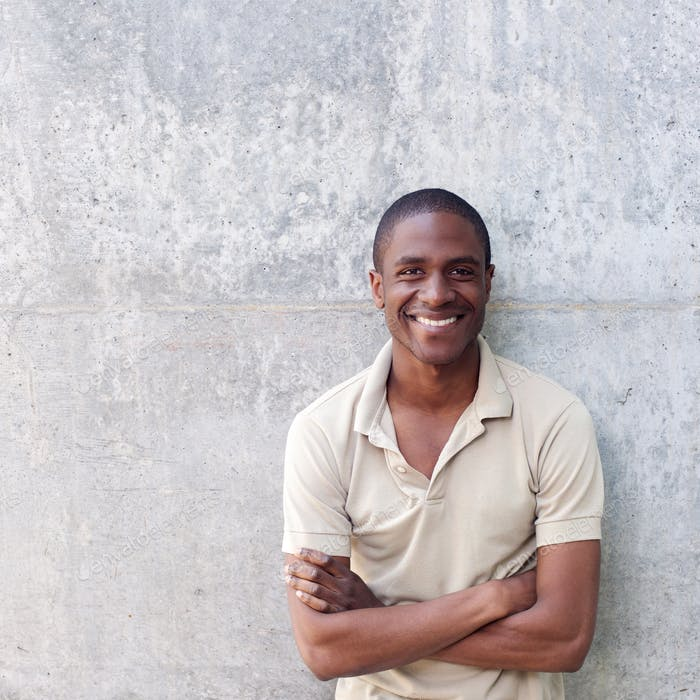 confident african american man smiling with arms crossed