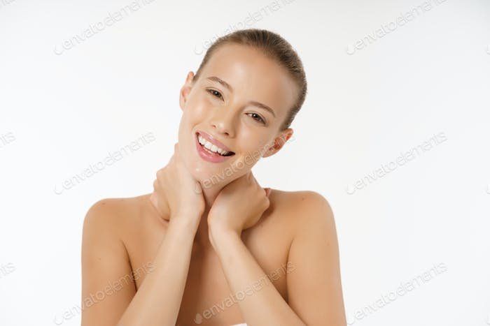 Beautiful young woman with clean fresh perfect skin. Portrait of model with natural nude make up