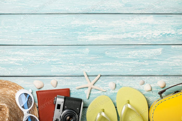 Vacation beach accessories and seashells on blue background