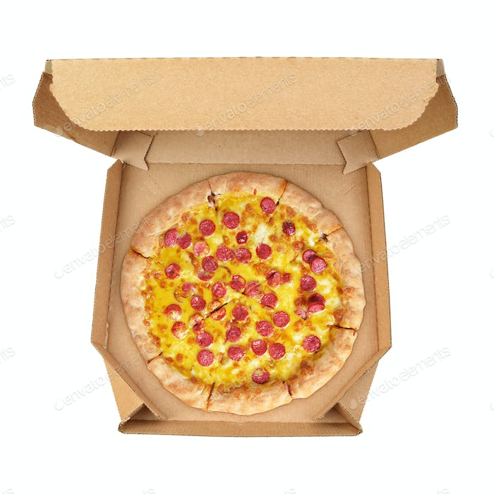Pizza with pepperoni sausages in brown take-out box isolated on white background.
