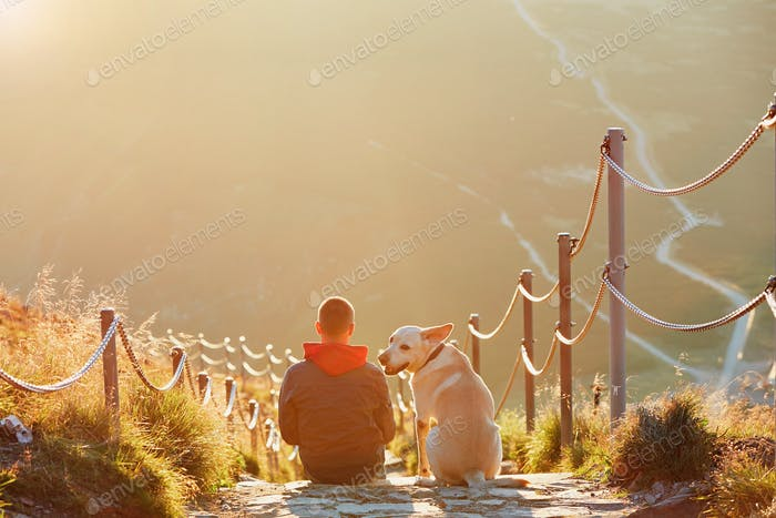Thumbnail for Man with dog on the trip in the mountains