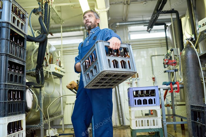 Brewing Plant Worker Carrying Crate