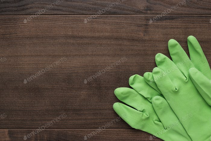 green rubber cleaning gloves