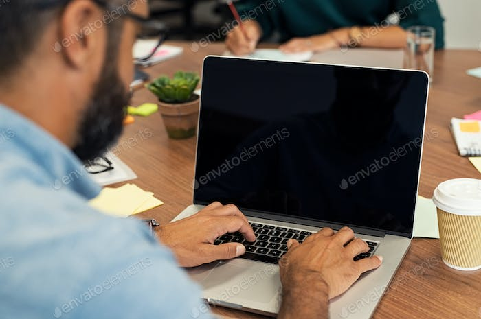 Business man typing on blank screen