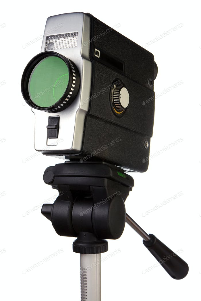 old film camera on tripod isolated on white