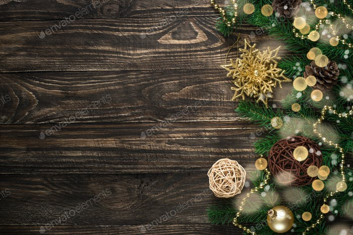 Christmas background with candle and decorations on dark wooden