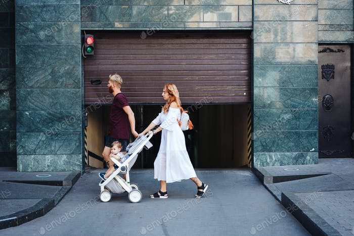 man and woman with a stroller