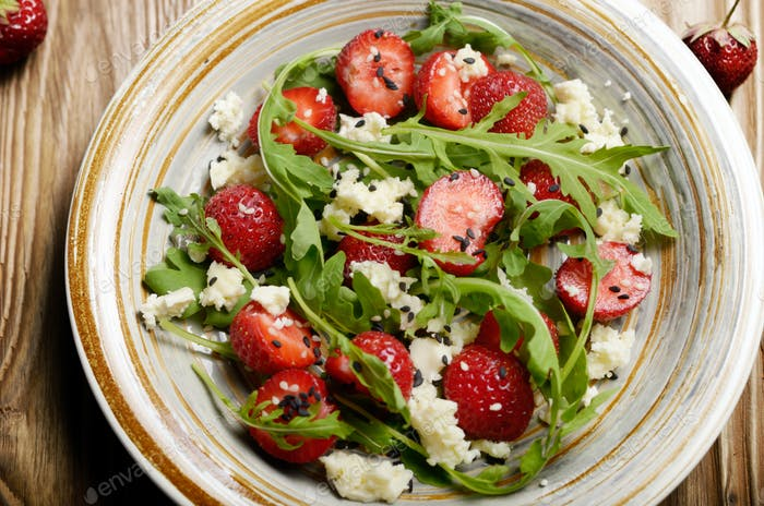 Strawberry arugula and feta cheese salad with chia seeds and ses