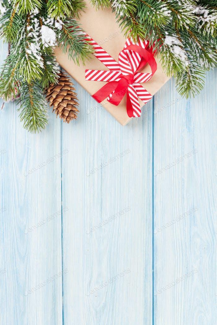 Christmas gift box and tree branch