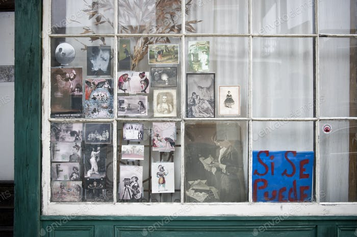 Vintage photographs in window in New Orleans, Louisiana