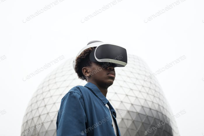 Man wearing VR headset outdoor futuristic technology