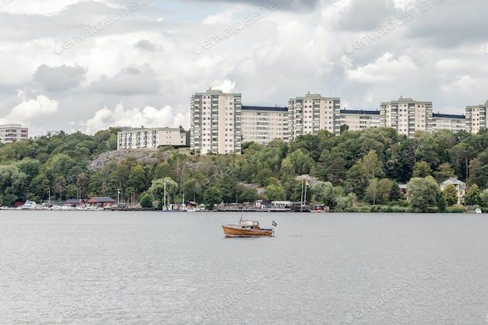 Modern city on a green riverside