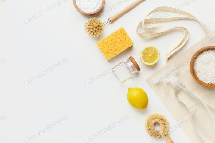 Vinegar, baking soda, salt, lemon and cloth on white