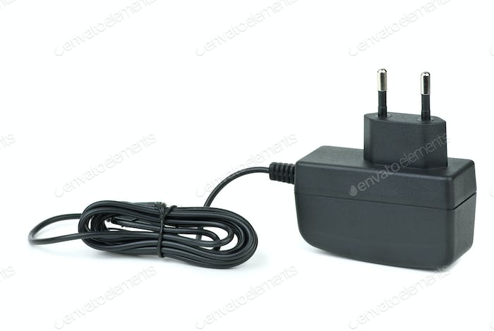 Small black power supply adapter