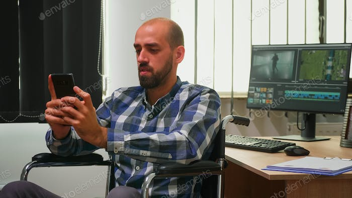 Disabled videographer searching on internet using smartphone