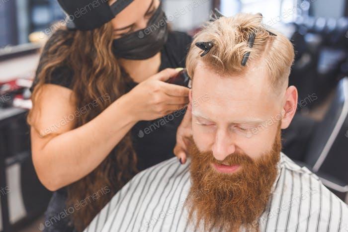 Men's haircut in a barbershop. Hair care