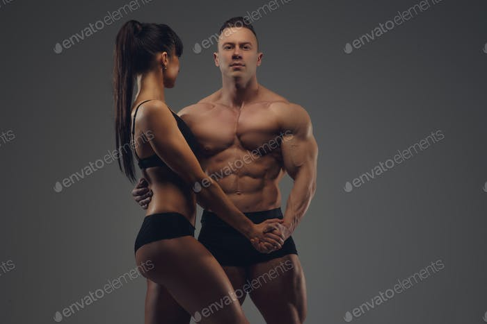Shirtless bodybuilder and fitness woman in underwear.
