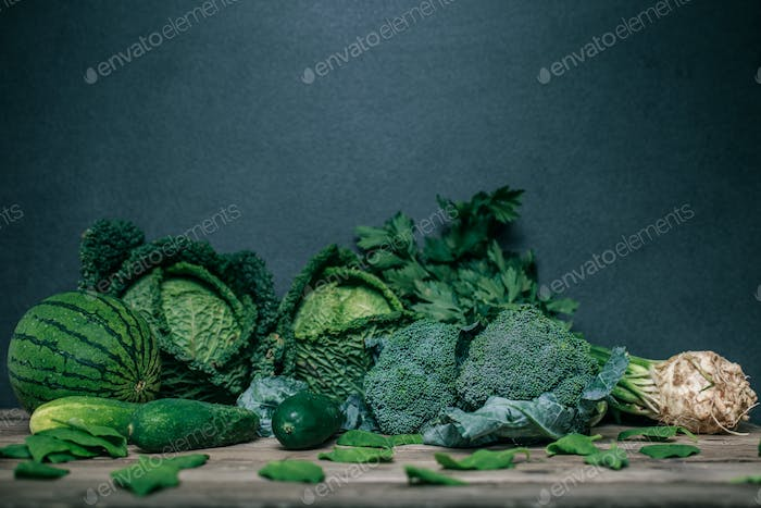 Various green vegetables on wooden table