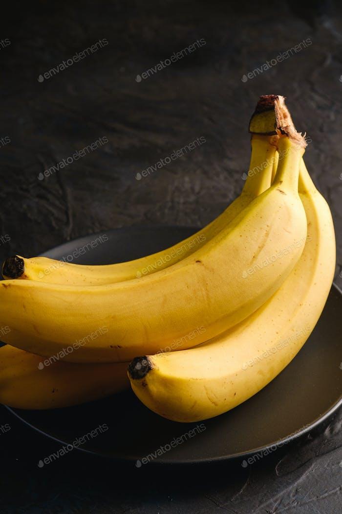 Banana fruits in black plate