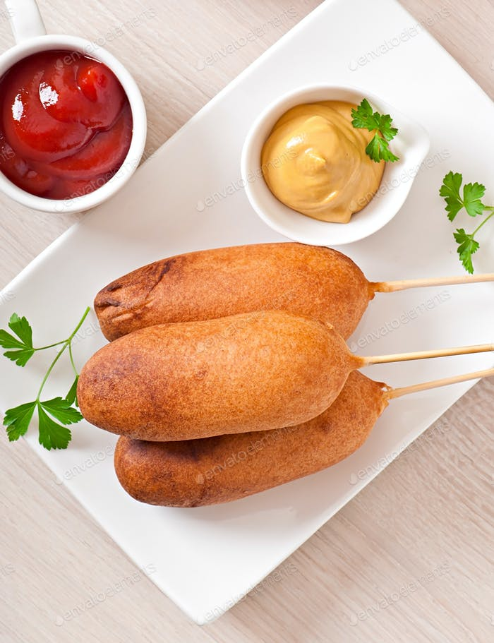 Homemade corn dogs with sauces