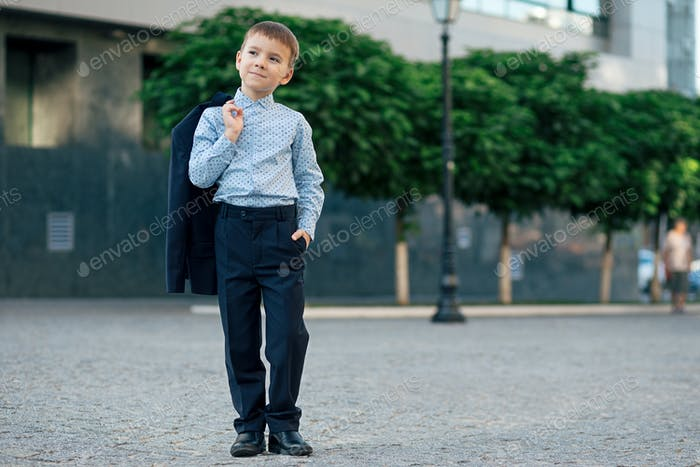 School boy posing in formal wear, elegant clothes