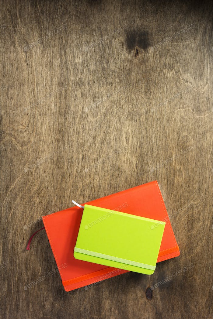 colorful notebook at wooden background