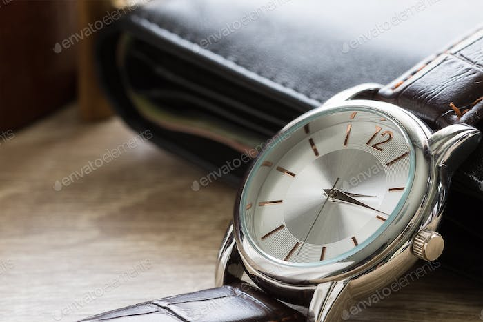 Close up watch and wallet